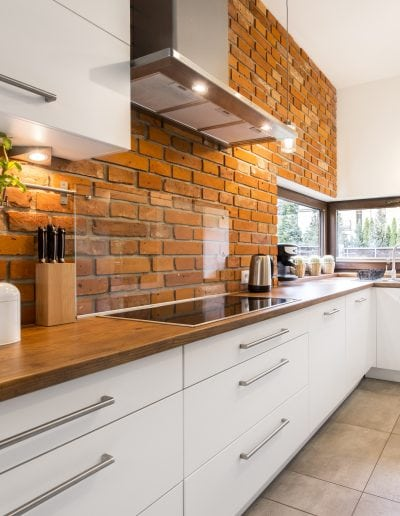 Brick wall in modern kitchen