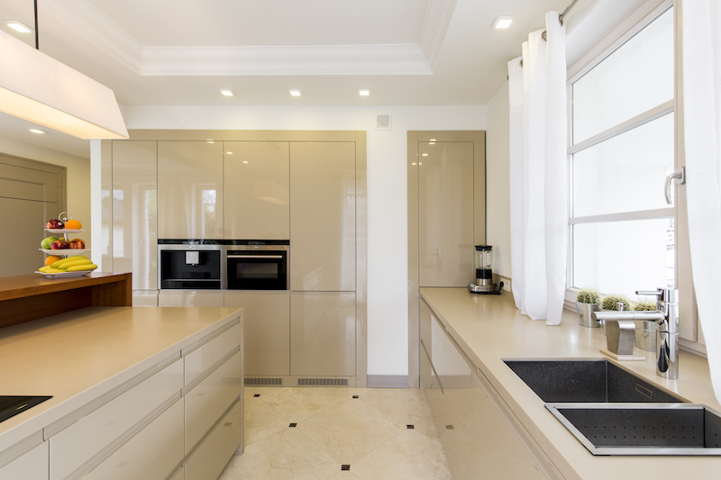 Kitchen with bright furnitures and sink